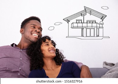 Happy Young Couple Dreaming About The Future Home