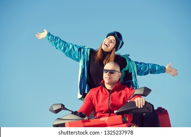 Happy young couple driving quad on snow mountain.Happy Life concept