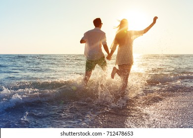 Happy young couple enjoying the sea