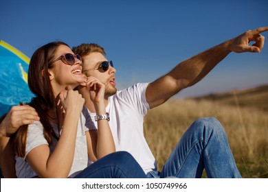 Happy young couple enjoys a sunny day in nature
