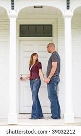 Happy Young Couple Entering Front Door