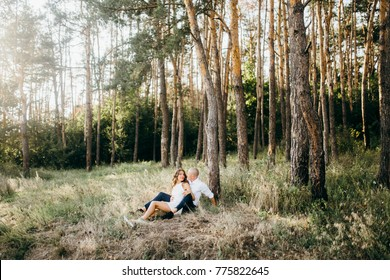 Happy young couple in the forest