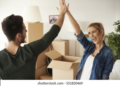 Happy and young couple giving high five