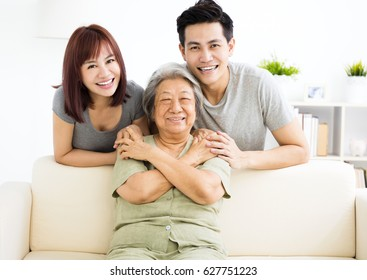 happy young couple with grandmother