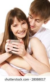 Happy young couple having a coffee