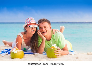 happy young couple having fun by the beach