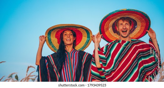 Happy young couple having fun outdoors together. Couple in love. Hat. Vacation concept. Photo. Sensual. Happy day. Celebration.