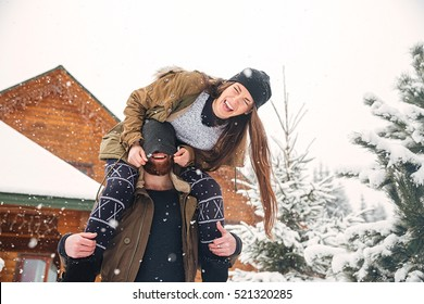 Happy young couple having fun and laughing in winter
