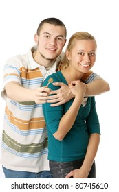 A happy young couple holding a key - on white background