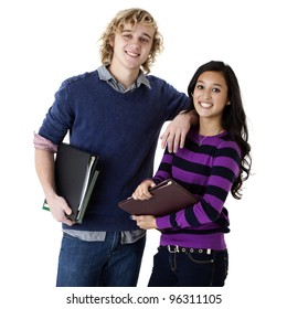 happy young couple holding school books