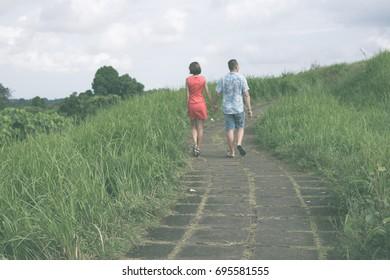 Happy young couple honeymoon on a tropical island of Bali.
