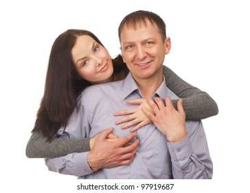 Happy young couple hugging, isolated on white background