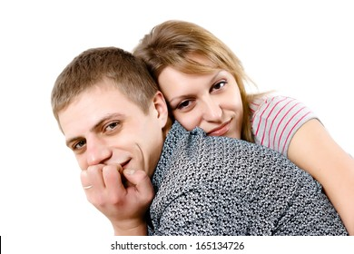 Happy young couple hugging on white background