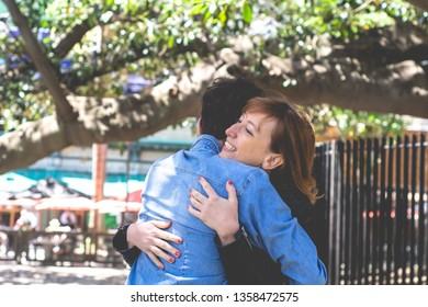 Happy young couple hugging in the park. Relationships concept