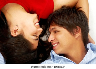 happy young couple kissing on the floor