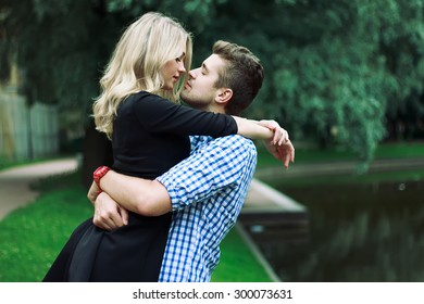 Happy Young Couple kissing in  the Park