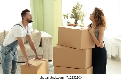 Happy and young couple looking at boxes