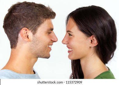 happy young couple looking at each other