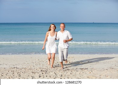 happy young couple in love having fun on the beach blue sky and sunshine