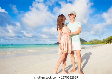 happy young couple in love having fun by the beach