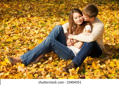 Happy young couple in love meeting in the autumn park