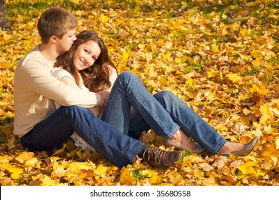 Happy young couple in love meeting on the autumn leaf