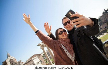 Happy young couple making selfie in Roman Forum at sunny day