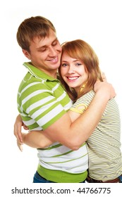 happy young couple, young man and woman embrace and laugh