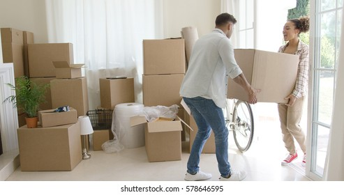 Happy young couple moving into a new house