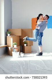 Happy young couple moving in new house. young couple