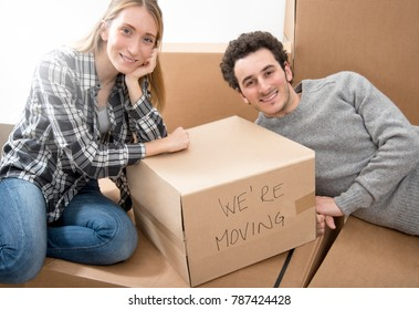 Happy young couple moving to new apartment