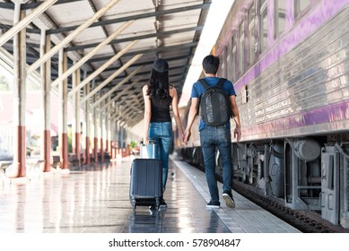 Happy young couple on railway station platform
