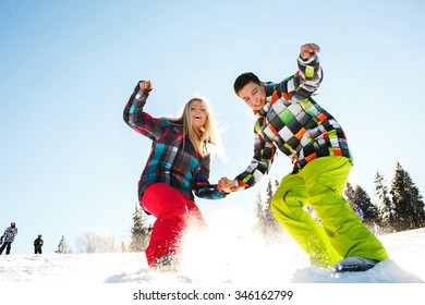 Happy young couple on vacation winter