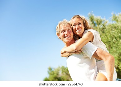 Happy young couple outdoors.