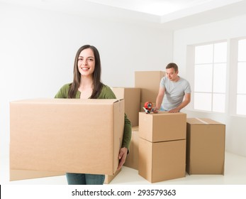 happy young couple packing, preparing to move house