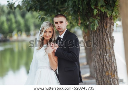 Happy Young Couple Poses For Photographers On Her Happiest Day Wedding