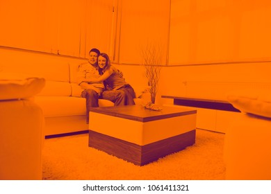 happy young couple relax at home in modern and bright living room duo tone