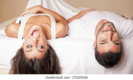 Happy young couple relaxing in a hotel room.
