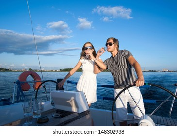 Happy young couple relaxing on a yacht