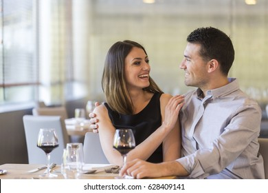 happy young couple in a restaurant
