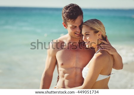 happy young couple romancing on beach stock photo edit now