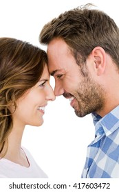 Happy young couple rubbing nose on white background
