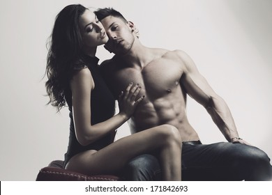 Happy young couple in sexual intercourse .Erotic photo, glamour colors.