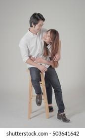 happy young couple shooting in studio