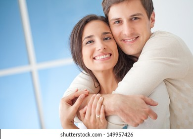 Happy young couple in their modern living room.