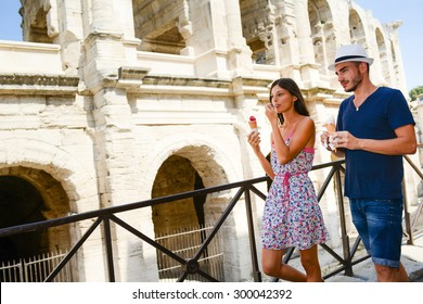 happy young couple tourist eating ice cream while visiting european city during summer
