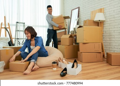 Happy young couple unpacking in their new apartment