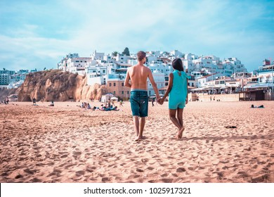 happy Young couple walking at the beach of Albufeira Algarve Portugal