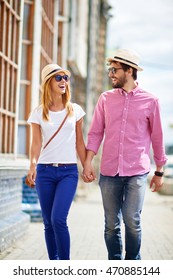 Happy young couple walking in the city