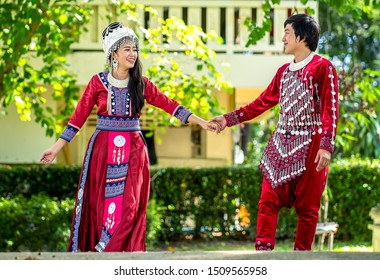 Happy young couple walking hand in hand and promised to take care of each other with love and caring. Lovers, Friendship and Valentine concept. Hmong couple.